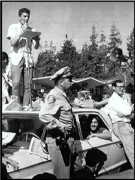 Police Car surrounded in front of Sproul Hall, Jack Weinberg can be seen in the back seat - Howard Harawitz photo - jpg (37296 bytes)